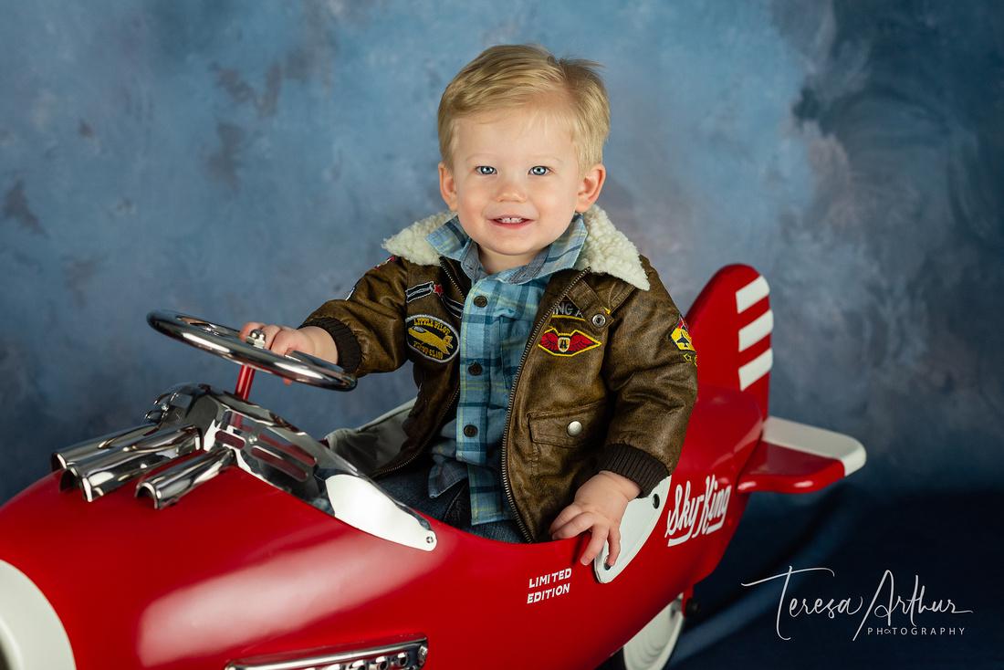 one year boy photo in plane