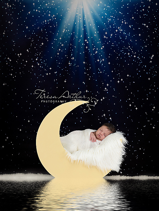 newborn in moon prop portrait by teresa arthur photography
