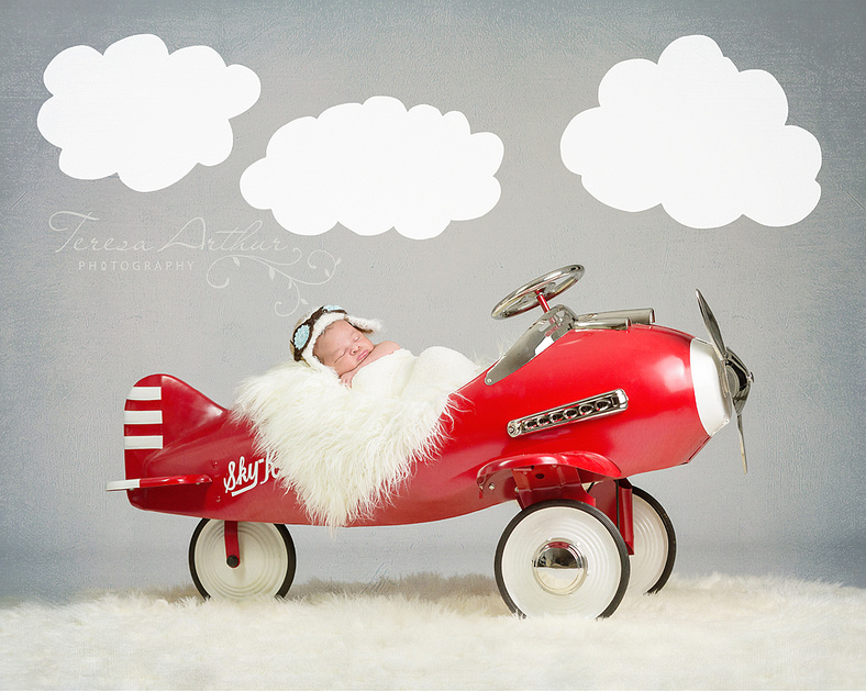 Newborn in airplane prop by Teresa Arthur Photography