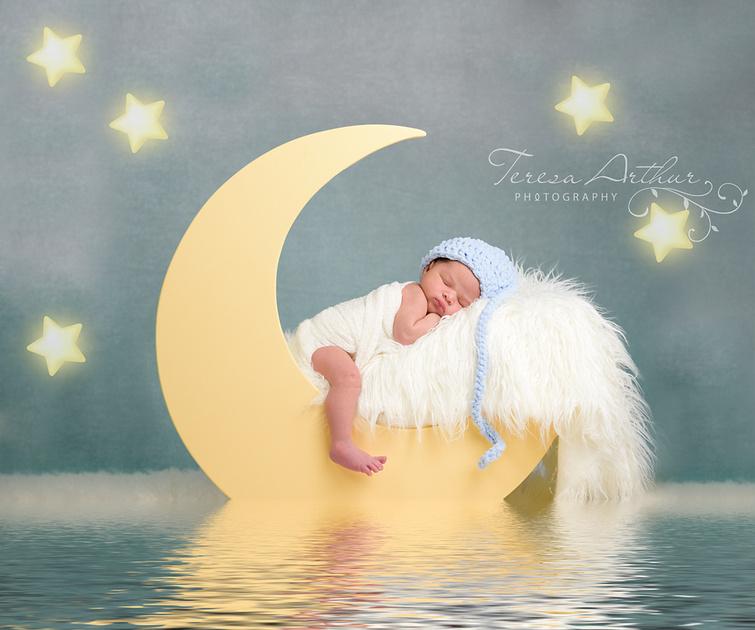 Newborn in Moon Prop Photo by Teresa Arthur Photography